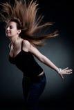 Mujer atractiva con el pelo soplado Imagenes de archivo