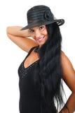 Mujer atractiva con el sombrero elegante Foto de archivo libre de regalías