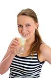 Mujer atractiva con el vidrio de agua Imagen de archivo libre de regalías