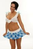 Mujer atractiva con la falda corta Fotografía de archivo libre de regalías