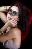 Mujer atractiva con las pulseras del oro y de la plata Fotos de archivo