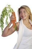 Mujer atractiva con las zanahorias Imagen de archivo libre de regalías