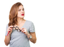 Mujer atractiva con los vidrios de lectura fotos de archivo libres de regalías