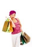 Mujer atractiva de las compras con las porciones de bolso multicolor Fotografía de archivo libre de regalías