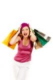 Mujer atractiva de las compras con las porciones de bolso multicolor Foto de archivo libre de regalías