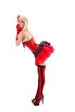 Mujer atractiva del cabaret en equipo rojo Imagen de archivo libre de regalías