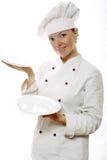 Mujer atractiva del cocinero con los platos Fotos de archivo libres de regalías
