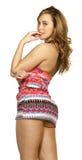 Mujer atractiva en falda corta Imagenes de archivo