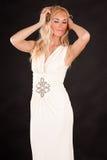 Mujer atractiva en un vestido beige Fotografía de archivo libre de regalías