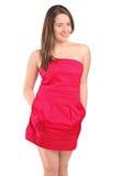 Mujer atractiva en una presentación roja de la alineada Imagen de archivo libre de regalías