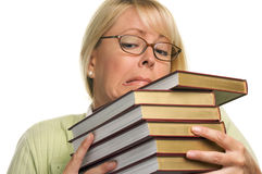 Mujer atractiva frustrada con la pila de libros Imagen de archivo libre de regalías