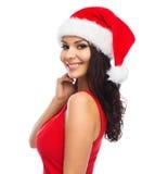 Mujer atractiva hermosa en el sombrero de santa y el vestido rojo imágenes de archivo libres de regalías