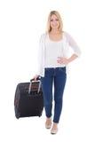 Mujer atractiva joven con la maleta aislada en blanco Imagen de archivo