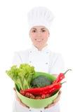 Mujer atractiva joven del cocinero en uniforme con el aislador vegetariano de la comida Fotografía de archivo libre de regalías