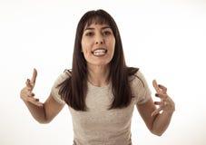 Mujer atractiva joven desesperada con la cara enojada que parece furiosa Expresiones y emociones humanas imágenes de archivo libres de regalías