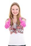Mujer atractiva joven en los pulgares de goma rosados de los guantes para arriba aislados Foto de archivo