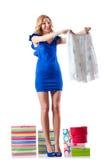 Mujer atractiva que intenta la nueva ropa Foto de archivo libre de regalías