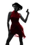 Mujer atractiva que sostiene la silueta del arma Fotos de archivo