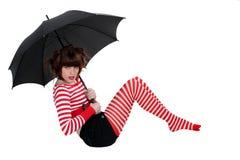 Mujer atractiva que sostiene un paraguas Foto de archivo