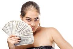 Mujer bastante joven con el dinero Foto de archivo