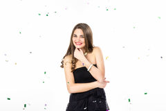 Mujer bastante joven con sonrisas del confeti Imagen de archivo libre de regalías