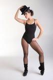 Mujer bastante joven en actitud de la danza Foto de archivo libre de regalías