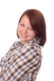 Mujer bastante joven en la camisa controlada, sonriendo Fotos de archivo