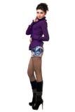 Mujer bastante joven en una falda del dril de algodón Fotografía de archivo