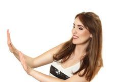 Mujer bastante joven que mira la manicura Foto de archivo