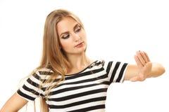 Mujer bastante joven que mira la manicura Fotografía de archivo libre de regalías