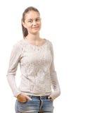 Mujer bastante joven que se coloca en el fondo blanco Imagen de archivo