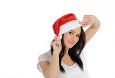 Mujer bastante ocasional divertida en sombrero de la Navidad Imágenes de archivo libres de regalías