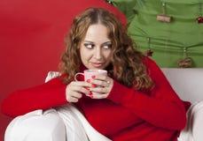 Mujer bastante rubia de los jóvenes en decoraciones del Año Nuevo Imagen de archivo libre de regalías
