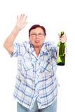 Mujer bebida mayor divertida Imagen de archivo