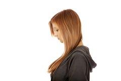 Mujer bonita adolescente triste o preocupante Imágenes de archivo libres de regalías