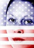 Mujer bonita con el indicador americano Imagen de archivo