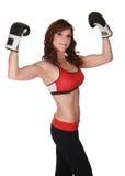 Mujer bonita con los guantes del boxe Foto de archivo libre de regalías