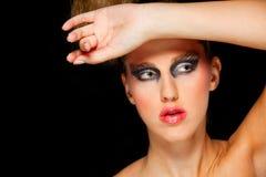 Mujer bonita con maquillaje extravagante Imágenes de archivo libres de regalías