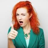 mujer bonita con su finger para arriba Imágenes de archivo libres de regalías