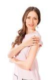 Mujer bonita delgada joven en la presentación rosada del vestido Fotografía de archivo libre de regalías