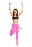 Mujer bonita en actitud de la yoga - media Lotus Tree Position. Imágenes de archivo libres de regalías