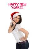 Mujer bonita en el sombrero rojo de la Navidad que hace un deseo Imágenes de archivo libres de regalías