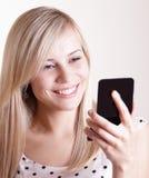 Mujer bonita joven con el espejo Fotos de archivo