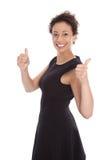 Mujer bonita joven con los pulgares para arriba en el fondo blanco Fotografía de archivo libre de regalías