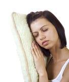 Mujer bonita joven con una almohada Foto de archivo libre de regalías