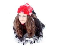 Mujer bonita joven que juega en la nieve Fotografía de archivo libre de regalías