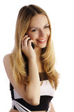 Mujer bonita que habla en el teléfono Fotografía de archivo libre de regalías