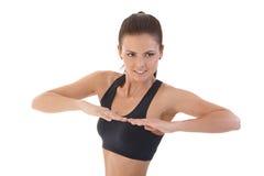 Mujer bonita que hace la sonrisa de los ejercicios Foto de archivo libre de regalías