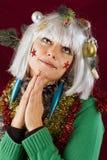 Mujer bonita que ruega para la Navidad Imágenes de archivo libres de regalías