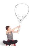 Mujer bonita que sostiene el dibujo del globo Imagen de archivo
